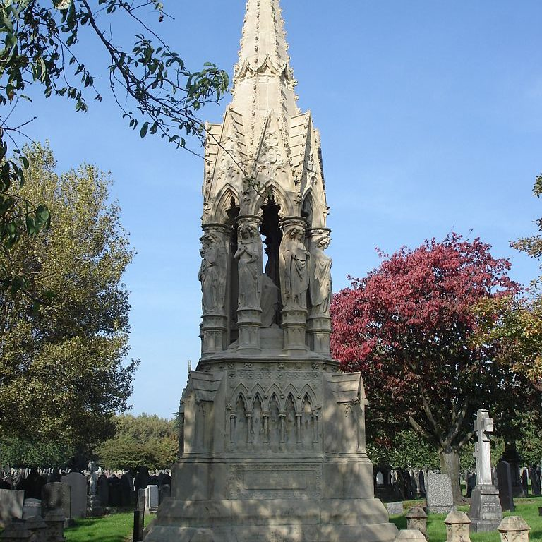 Stone grave monument in the form of a tall gothic spire