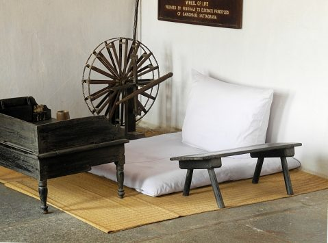 White cushions, low desk, and portable spinning wheel